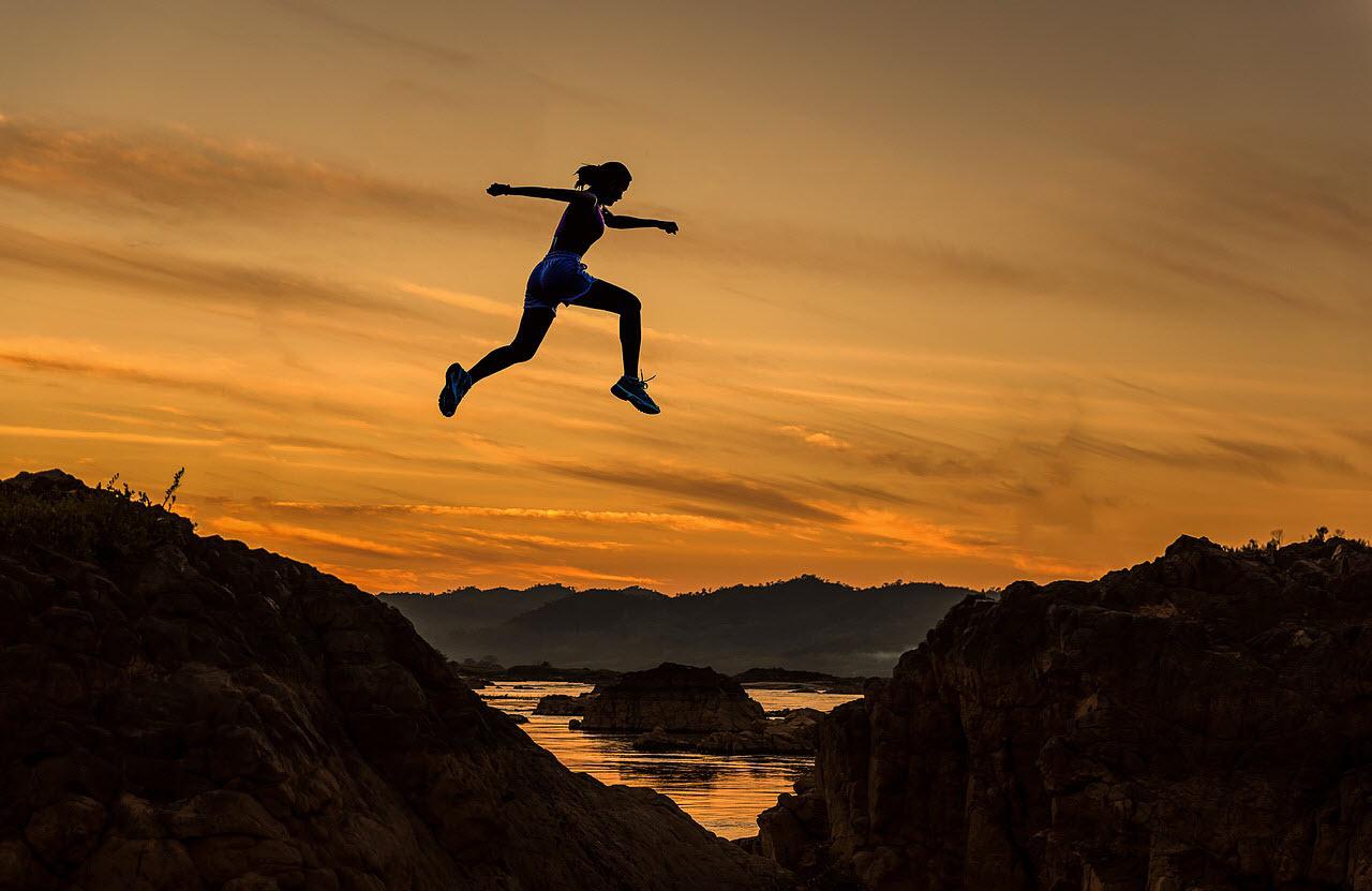 woman jumping goal setting